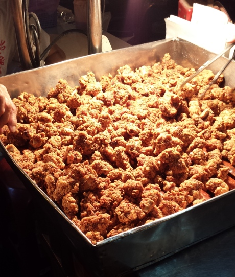 Chicken nuggets with a lot of black pepper.