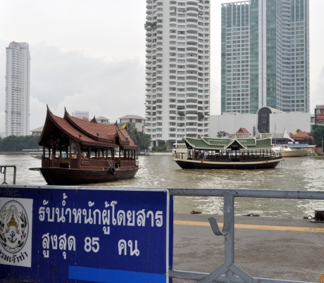 Ferry boats for guests of local hotels such as The Peninsula on the left bank.