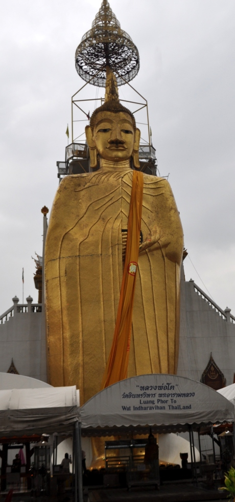 The Buddha is big. About 60' tall. It is called Luang Phor To. The name of the temple is Wat Intharavihan.