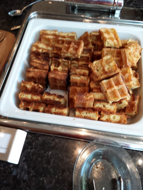 Got to have waffle with maple syrup.