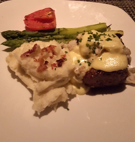 Filet Oscar with Bearnaise sauce, mash potato and asparagus.  Beef is a little over done. Others were good. I ate some steak even though I may or may not have gout. What the hack.