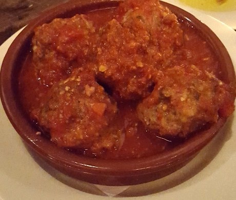 Meatballs were firm with a lot of flavoring The sauce was great with bread.