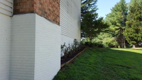 One layer of masonry paint: glacier white.
