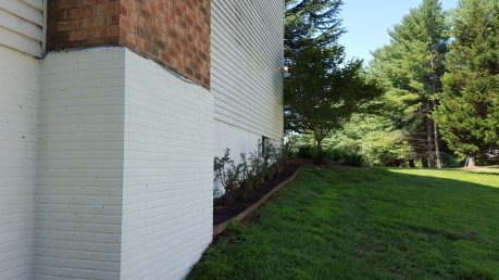 One layer of masonry paint: glacier white.